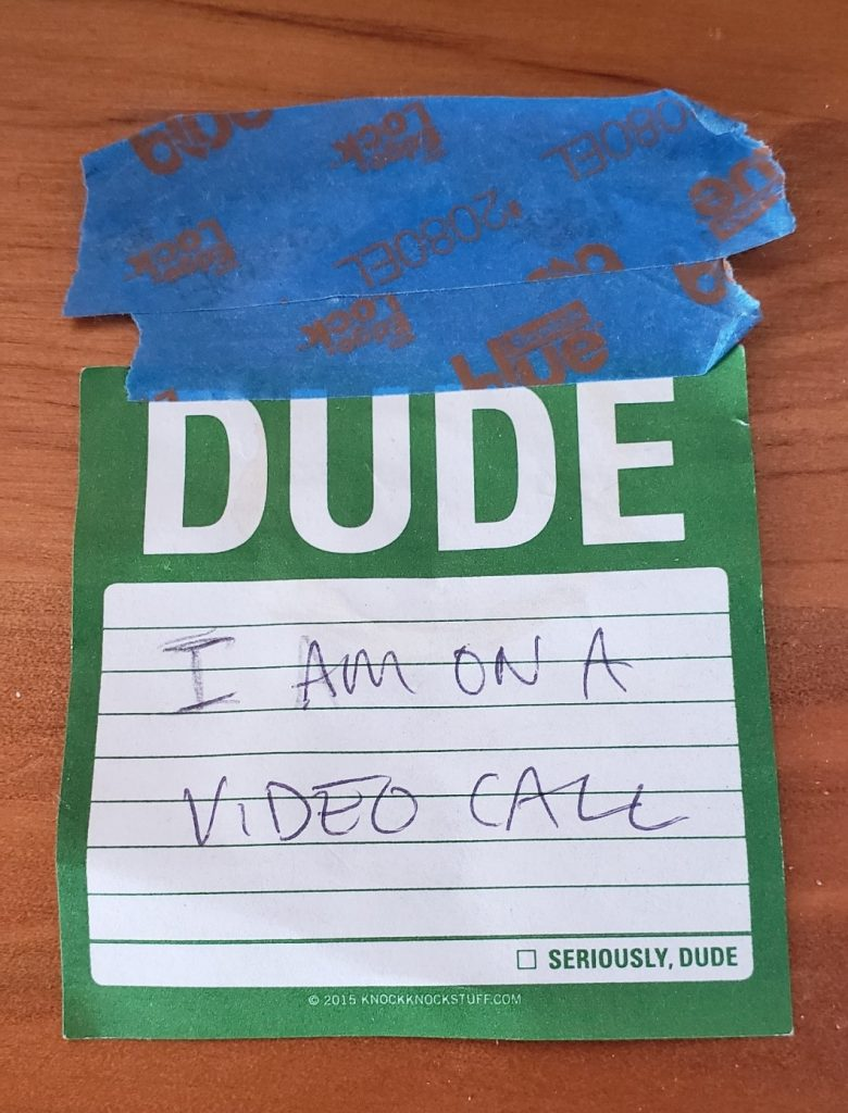 "A close up of text on a white surface. ""Dude, I'm on a video call""  Description automatically generated"