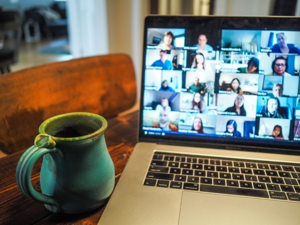 Image of a multi-person virtual meeting on a home laptop.
